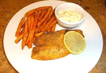 Picture of pan-fried tilapia, ready to serve with spicy French fries/ www.super-seafood-recipes.com