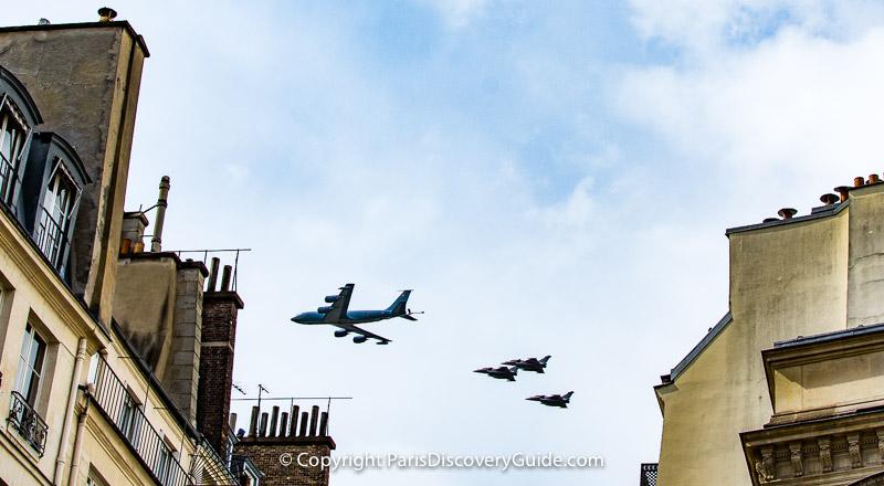Bastille Day military flyover seen from rue Molière near Palais Royal