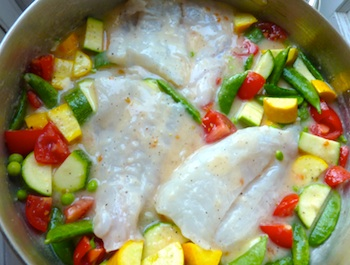 Picture of cod baked with lemon garlic sauce and vegetables