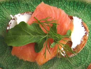 Photo of Brushetta with a layer of chevre, smoked salmon, arugula, and dill / www.super-seafood-recipes.com