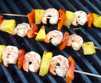 Picture shrimp kabobs cooking on a grill / www.super-seafood-recipes.com