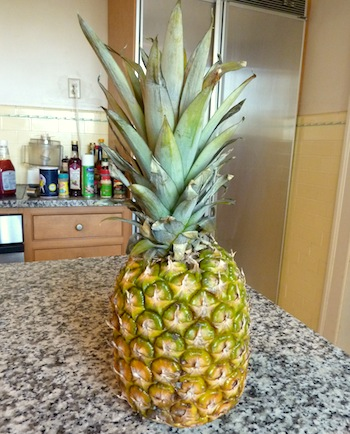 Picture of ripe pineapple ready to be cut into pieces / www.super-seafood-recipes.com