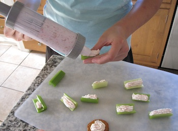Photo of Using a pastry tube to distribute the smoked salmon spread / www.super-seafood-recipes.com