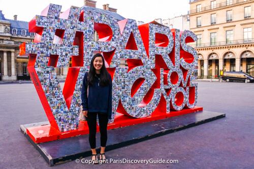 The City of Paris Loves Visitors sign in Paris, France