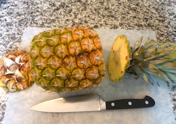 Picture of ripe pineapple with top and bottom sliced off / www.super-seafood-recipes.com