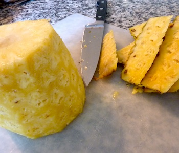 Photo of fresh pineapple being trimmed / www.super-seafood-recipes.com